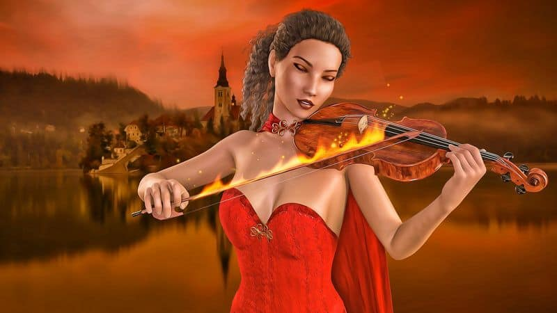 Woman playing fiddle with flaming bow