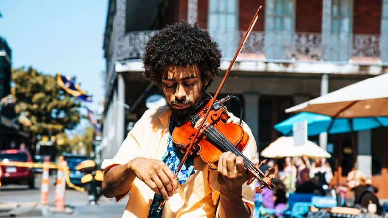Man playing fiddle in public
