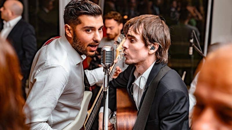 Two men singing at a wedding