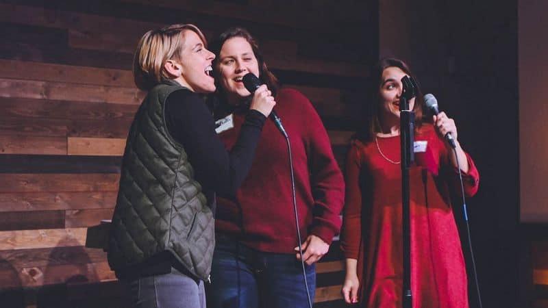 3 women singing karaoke