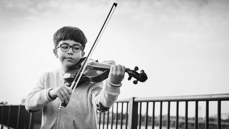 child playing a smaller violin