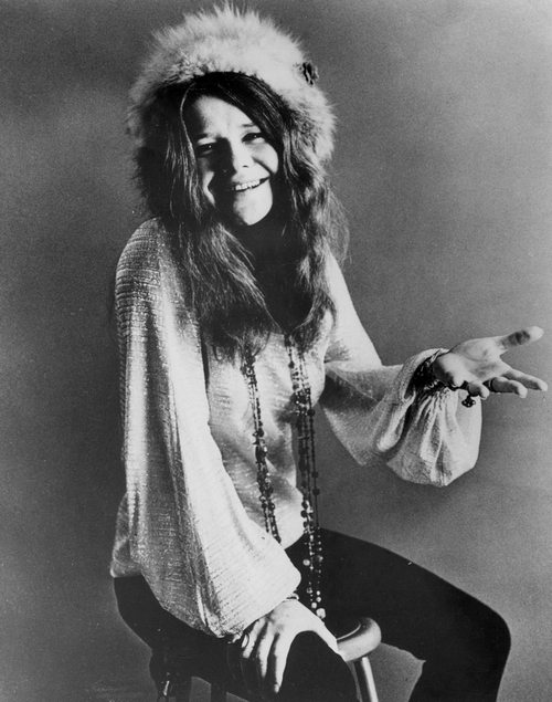 Janis Joplin sitting on chair