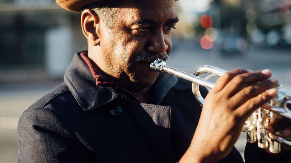 Trumpeter using triple tongue technique