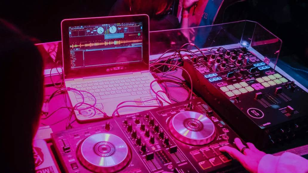 DJ setup with controller and laptop