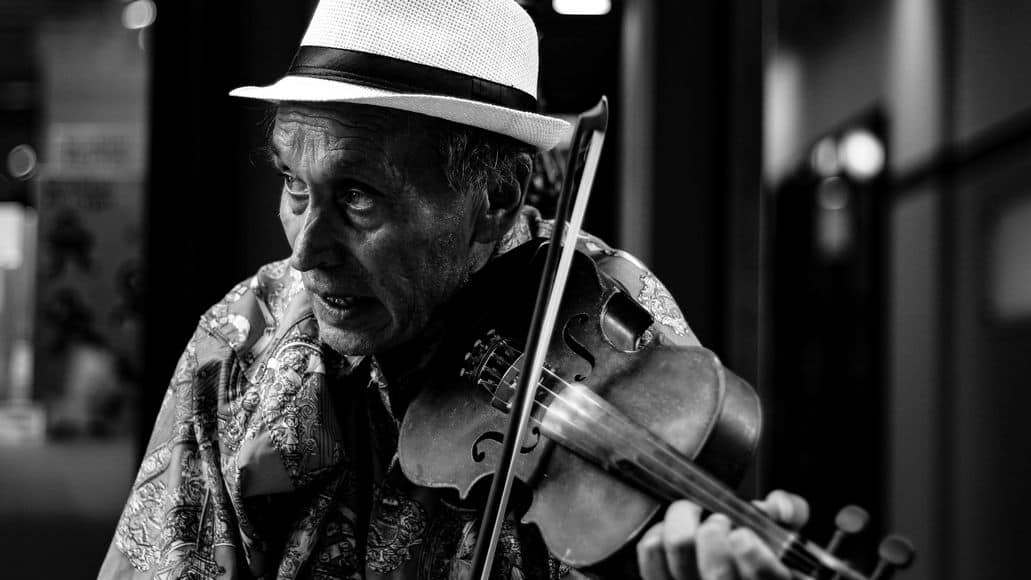 Elderly man playing violin