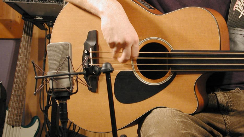 Guitarist using TLM 103 microphone
