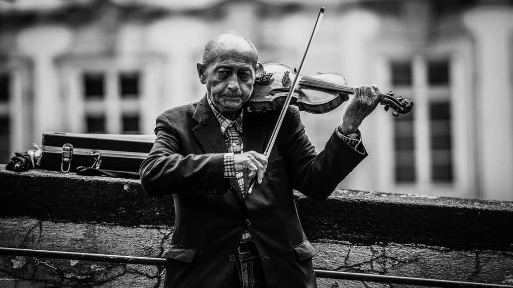 Old man practicing the violin