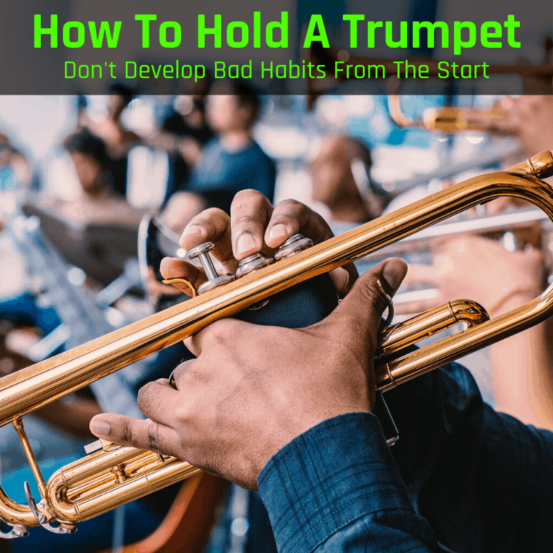 Holding a trumpet