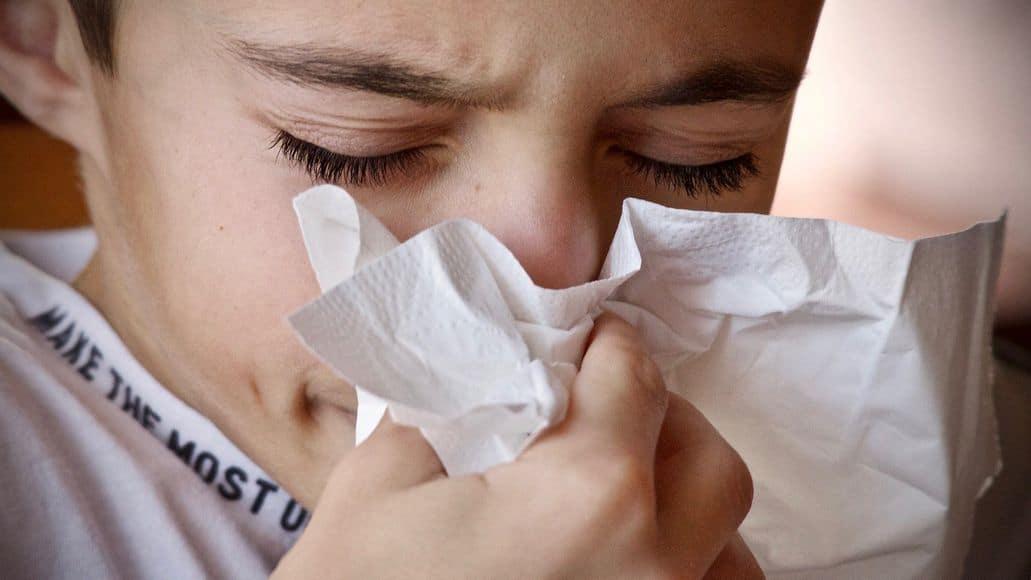 Woman blowing a stuffy nose