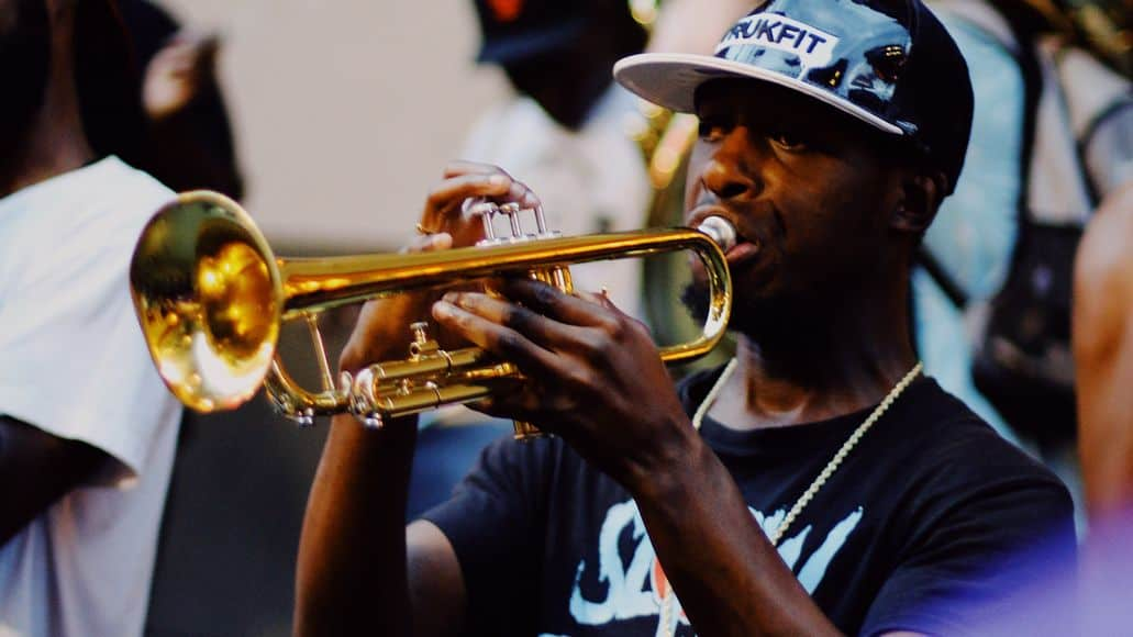 Holding the trumpet straight out