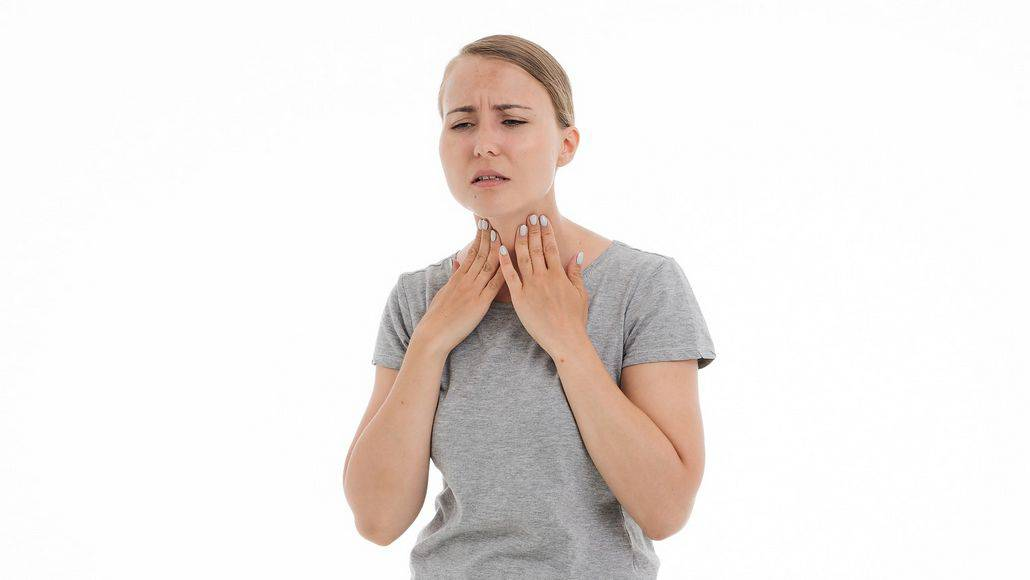 Woman with sore throat and mucus