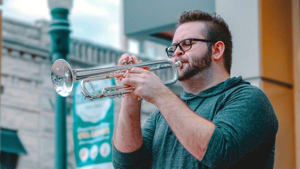 Man playing standard trumpet