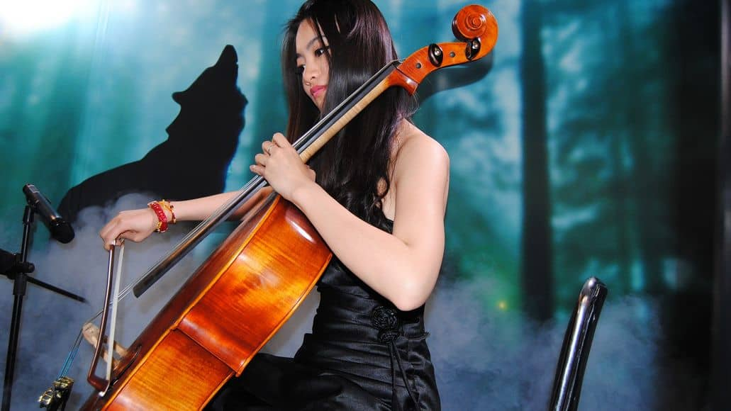 Woman holding cello in playing position