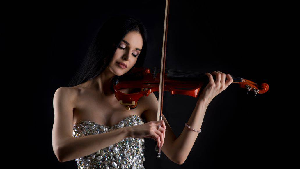 Sexy woman playing the electric violin