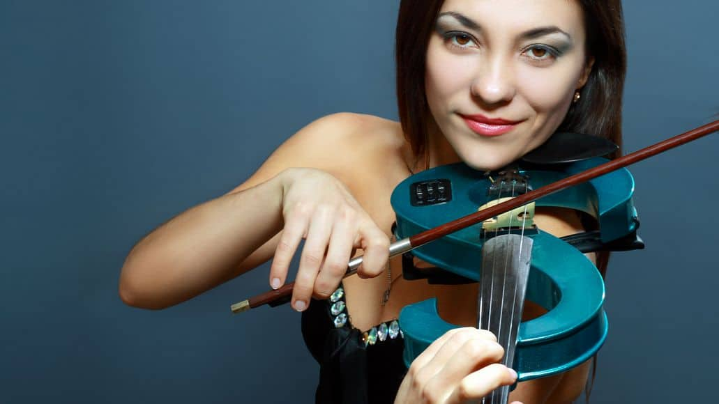 Beautiful girl playing electric violin