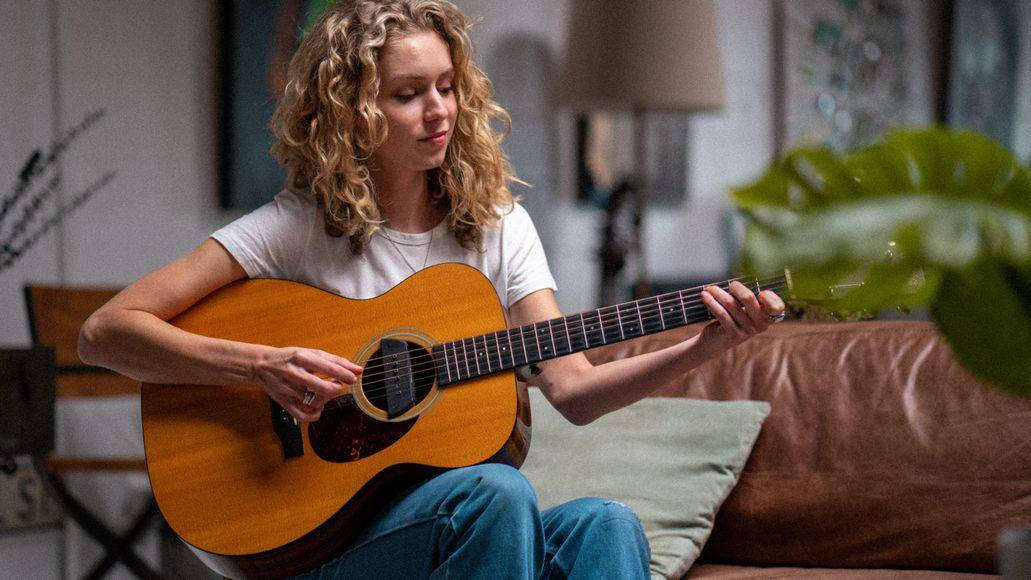 Woman practicing a song on the guitar