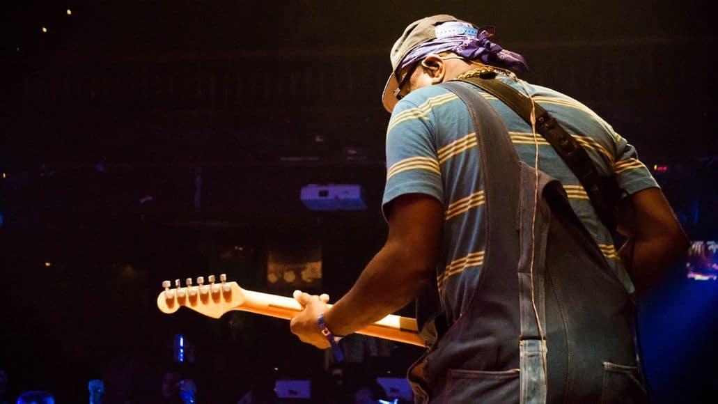 Guitarist playing baritone guitar