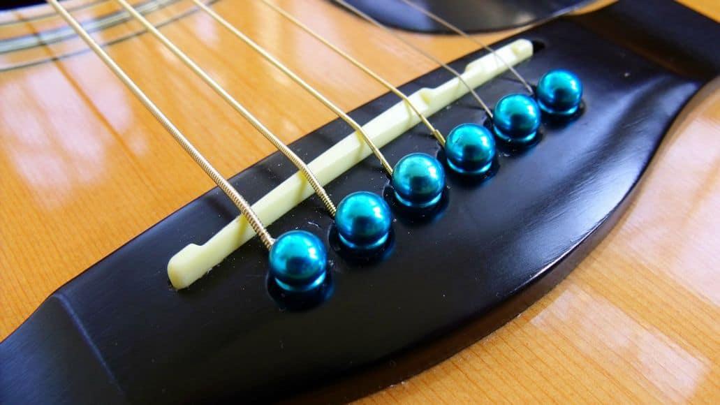 Bridge pins on acoustic guitar