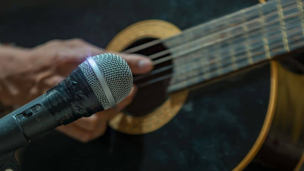 Microphone recording an acoustic guitar