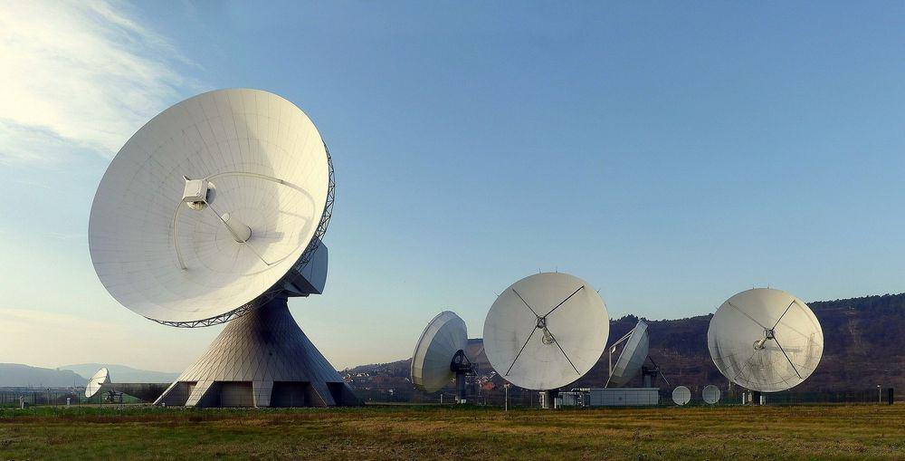 Radio dishes creating electromagnetic waves