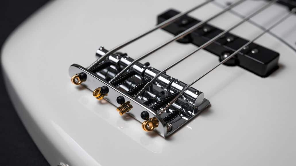 white 4 string bass guitar